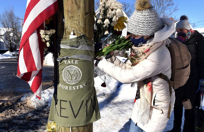 Yale postdoctoral students Maria Kochugaeva, left, and Elvira Mulyukova leave flowers at a memorial for Yale School of the Environment grad student Kevin Jiang at the corner of Lawrence and Nicoll Street in New Haven, Conn., Monday, Feb. 8, 2021, near where Jiang was killed on Feb. 6, 2021.