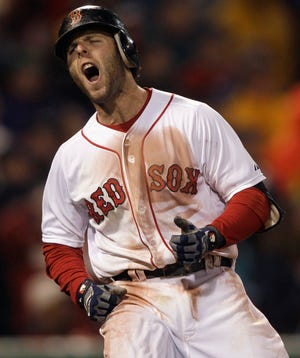 Boston Red Sox's Dustin Pedroia reacts after flying out with two men on base during the seventh inning against the Baltimore Orioles in a baseball game at Fenway Park in Boston, Monday, May 16, 2011.