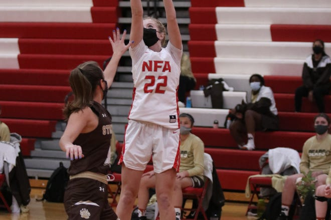 NFA senior guard Sarah Erickson takes a shot during the Wildcats' 59-42 Senior Night win against Stonington on  Saturday night at Norwich.
