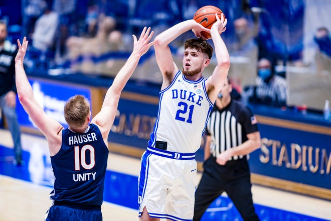 Matthew Hurt (21) scored 22 points to lead Duke to a 66-65 win against No. 7 Virginia on Saturday. It was the Blue Devils' first victory against a ranked opponent this season.