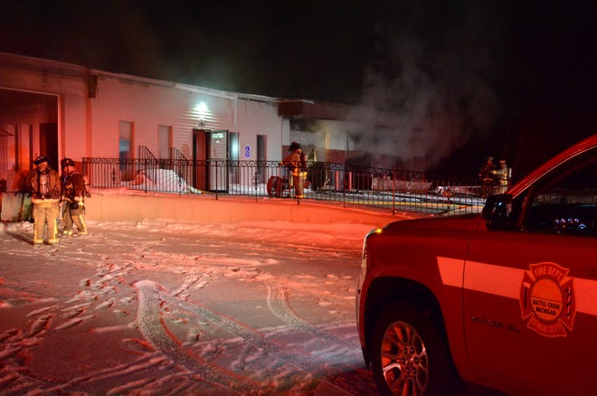 Battle Creek firefighters at the scene of a Saturday fire at 298 Hamblin Ave.  (Trace Christenson/The Enquirer)