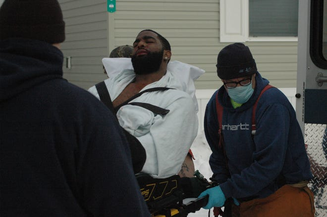 Roemontoe Roger Williams is taken to an ambulance after being shot Saturday in Springfield.  (Trace Christenson/The Enquirer)