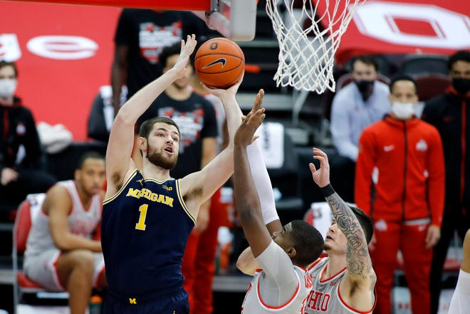 Michigan Wolverines center Hunter Dickinson shoots against Ohio State on Sunday, Feb. 21, 2021 in Columbus Ohio at Value City Arena.