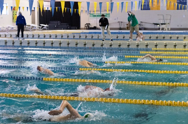 Swimmers compete during the IHSAA Boys Swimming Sectional prelims at Castle High School pool in Newburgh, Ind. Saturday afternoon, Feb. 20, 2021.