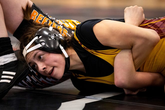 Poplar's Jazmin Gorder, facing, wrestles Chinook's Rebecca Stroh in the 113 pound final of the MHSA Girl's Wrestling State Tournament in Lockwood Saturday. Gorder won the bout by pinfall.