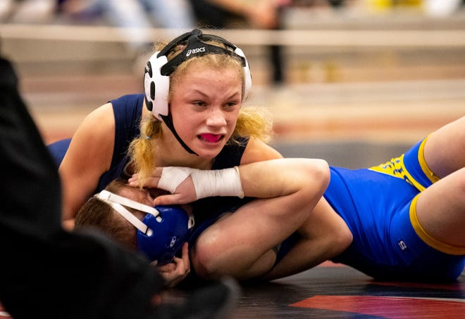 Great Falls freshman Kaylin Taylor goes for the pin against Shepherd's LeeAnn Hoch in the 103 pound finals of the MHSA Girl's Wrestling State Tournament at Lockwood High School Saturday.