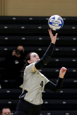 Purdue outside hitter Caitlyn Newton (4) hits the ball during the second set of an NCAA women's volleyball game, Saturday, Feb. 20, 2021 at Holloway Gymnasium in West Lafayette.