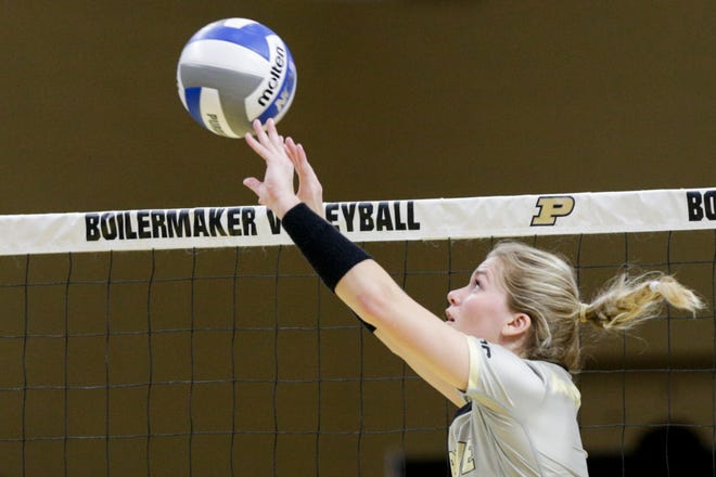 Purdue setter Hayley Bush (2) sets the ball during the fourth set of an NCAA women's volleyball game, Saturday, Feb. 20, 2021 at Holloway Gymnasium in West Lafayette.