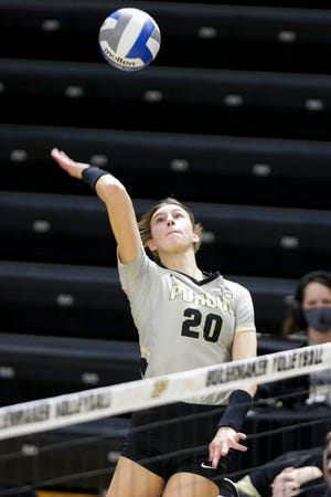 Purdue outside hitter Grace Cleveland (20) goes up for a hit during the first set of an NCAA women's volleyball game, Saturday, Feb. 20, 2021 at Holloway Gymnasium in West Lafayette.