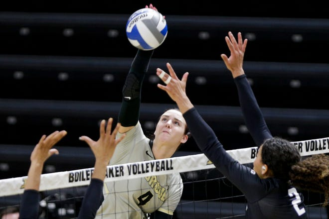 Purdue outside hitter Caitlyn Newton (4) hits the ball during the first set of an NCAA women's volleyball game, Saturday, Feb. 20, 2021 at Holloway Gymnasium in West Lafayette.