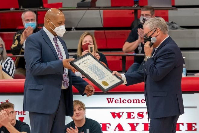 Senator Ron Alting presents West Lafayette boys basketball coach David Wood with a Distinguished Hoosier Award prior to Saturday's home game against Lebanon.