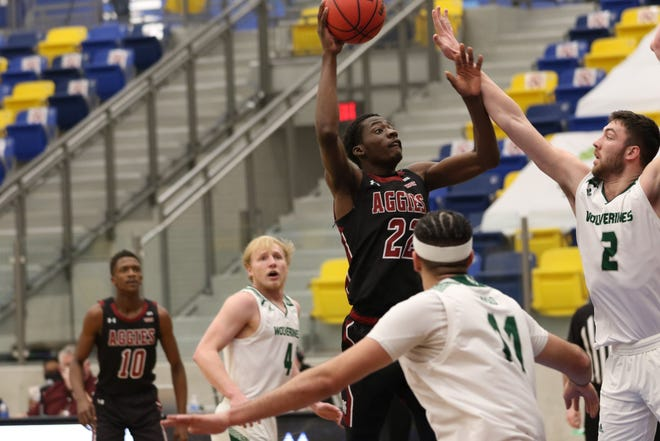 Redshirt junior forward Wilfried Likayi elevates for a shot during New Mexico State's semi-home game against Utah Valley on Feb. 20, 2021, at Eastwood High School in El Paso, Texas.