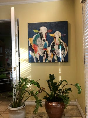 I have a painting of three cows, two big, one small, in my living room. I don't know why, but as soon as I saw it, I started to cry.