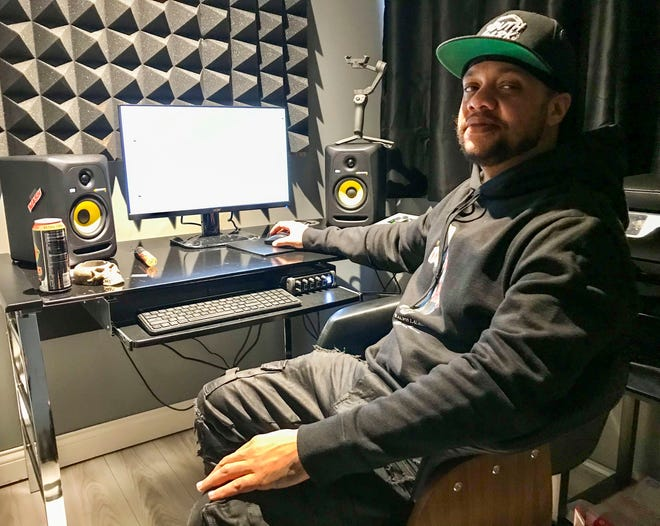 Hip-hop artist Shawn Anderson, who goes by Substance810, poses for a portrait in his New Haven home studio on Feb. 17, 2021.