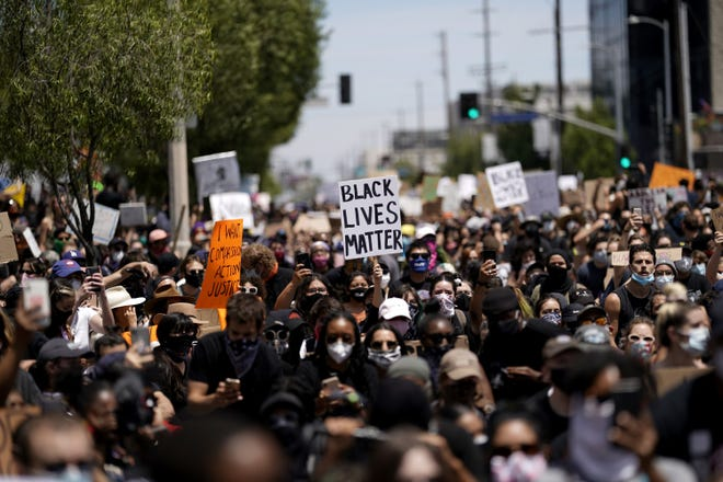 Demonstrators at Pan Pacific Park in Los Angeles on May 30, 2020, to protest police brutality and the killing of George Floyd by the Minneapolis police. (Kent Nishimura/Los Angeles Times/TNS)