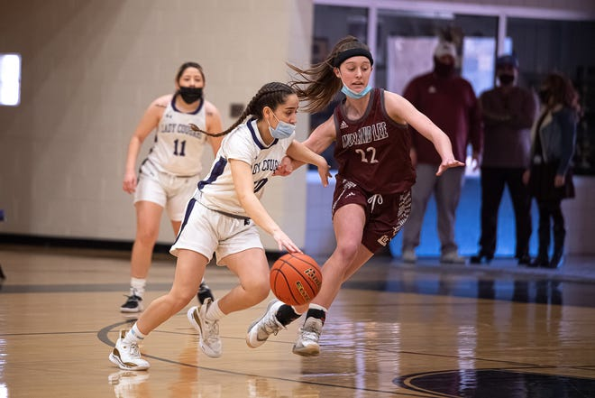 Franklin's Caitlynn Clark charges past a defender. Franklin High School defeated Midland Lee 55-36 to win the class 6A bi-district championship at Franklin High School on Feb. 20, 2021.