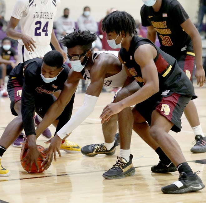 Players chase a loose ball during a Mount Vernon-New Rochelle varsity basketball game at New Rochelle High School Feb. 21, 2021.