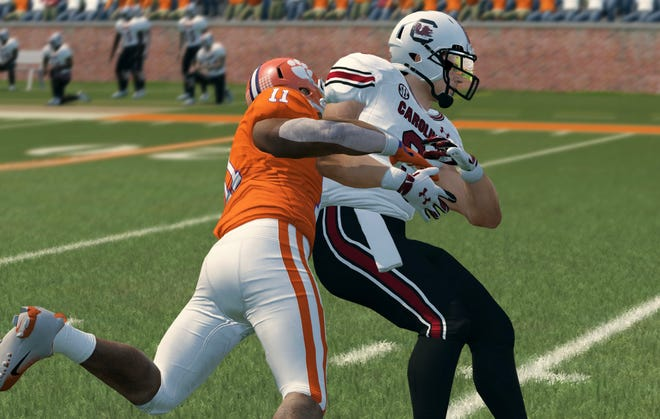 """The latest """"NCAA Football 14"""" update from College Football Revamped includes new uniforms for teams such as Clemson and South Carolina, as well as turf tape, which is new to the game."""