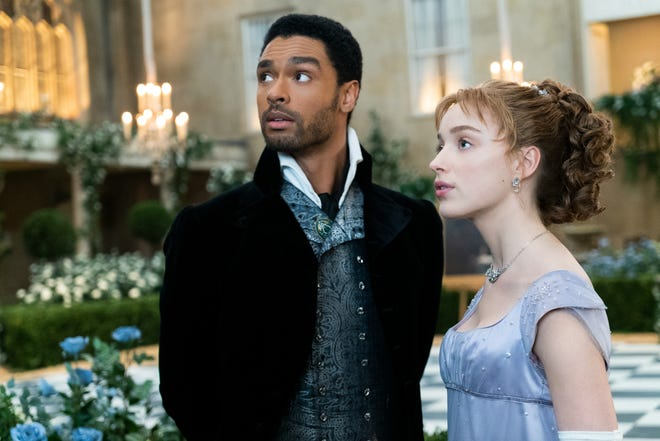"""Regé-Jean Page and Phoebe Dynevor in a scene from Netflix's """"Bridgerton."""""""
