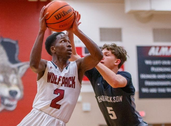 """Weiss junior guard Corey Penson, attempting a shot against Hendrickson in a February game, said COVID-19 robbed his team of """"gaining a rhythm and gaining chemistry with one another"""" during the offseason."""
