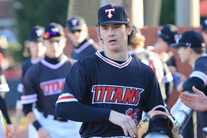 North Oconee senior Bubba Chandler prepares to pitch in Titans' season opener.