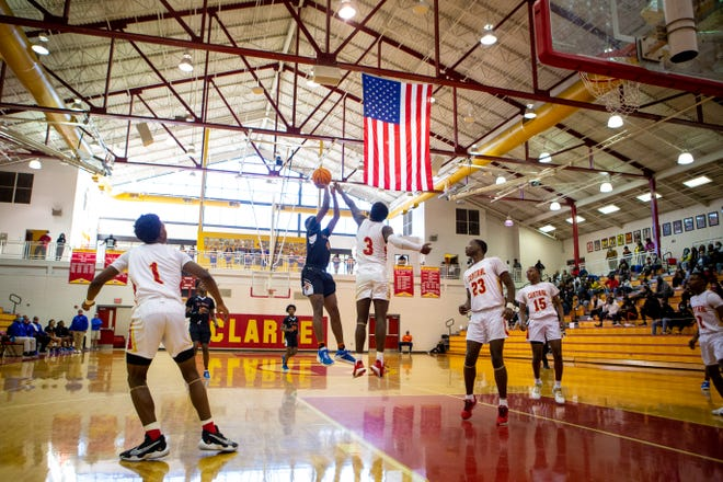 Clarke Central's Nono Mack (3) tries to block a shot during a boys high school basketball game between the Cedar Shoals Jaguars and the Clarke Central Gladiators. Other Gladiators include JJ Mack (1), Rio Foster (23), Jaylen Monroe (15) and AJ Jewell (2). (Casey Sykes for The Athens Banner-Herald)
