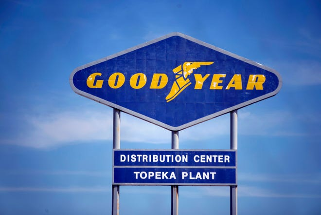 In this Aug. 20, 2020, file photo, signage for the Goodyear Distribution Center stands in Topeka, Kansas. Goodyear Tire and Rubber Co. is acquiring Cooper tires in a deal valued at $2.5 billion that will combine the two century-old Ohio companies.