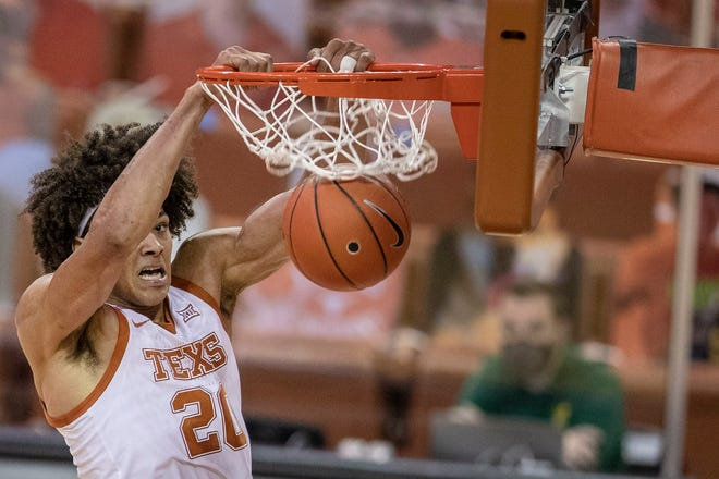 Texas forward Jericho Sims scores on a slam dunk during the Feb. 2 loss to Baylor at the Erwin Center. The Longhorns host Kansas on Tuesday in what will be their final home game of the season.