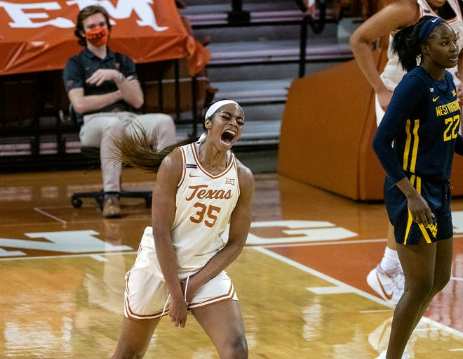 Texas Charli Collier, (35), celebrates one of her three-point baskets against West Virginia during the first half of an NCAA college basketball, Saturday, February 6, 2021, in Austin, Texas.
