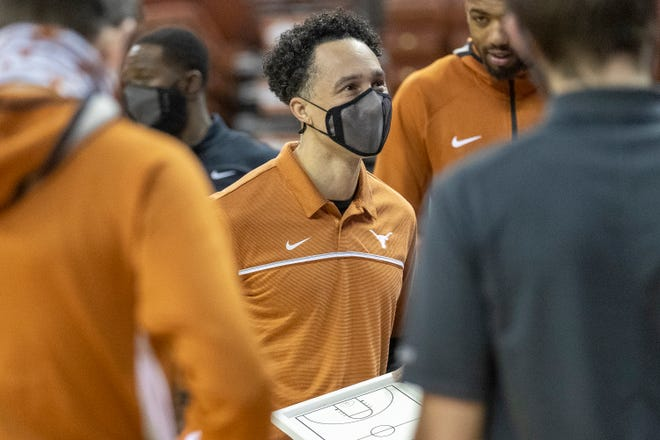 Texas head coach Shaka Smart speaks with his team before competing against West Virginia in Austin on Saturday. Smart and the Longhorns had three road games rescheduled for after their home finale Tuesday against Kansas.