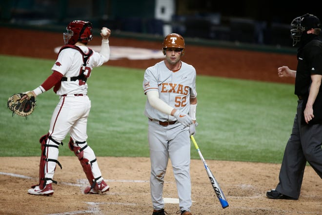 Texas' Zach Zubia heads back to the dugout after striking out during Sunday's 4-0 loss to Arkansas. The Longhorns struck out 15 times, 11 of which were swinging strikeouts.