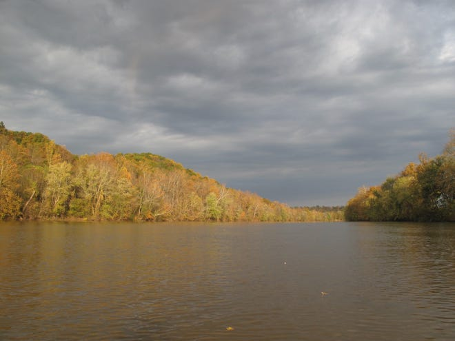 Taken on the last day of my 60th birthday canoe trip, this was the one moment a few rays of sunshine broke through the dark clouds over the Muskingum River.