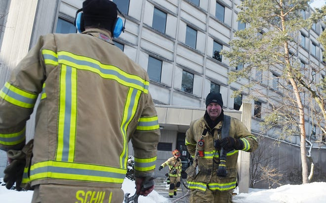 Ames firefighters clean up the scene after a fire at Iowa State University's Ross Hall in the center of campus Monday morning,  Feb. 22, 2021, in Ames, Iowa.