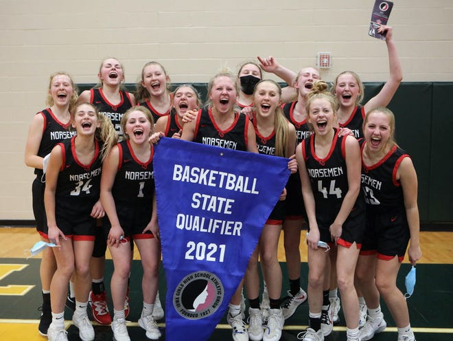 The Roland-Story girls' basketball team celebrates with its girls' state basketball qualifier banner after defeating Des Moines Christian, 38-29, in the Class 3A regional finals Saturday at Saydel High School in Des Moines. The Norse will face Unity Christian (22-2) in the 3A state quarterfinals next Tuesday at 9 a.m. in Des Moines.