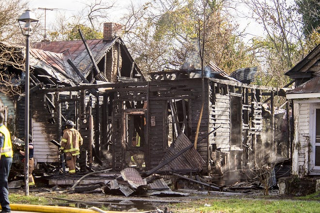 Augusta Firefighters respond to the 100 block of Telfair Street in Augusta on Monday afternoon where they found four houses on fire. One bystander was injured trying to get into a home to look for occupants.