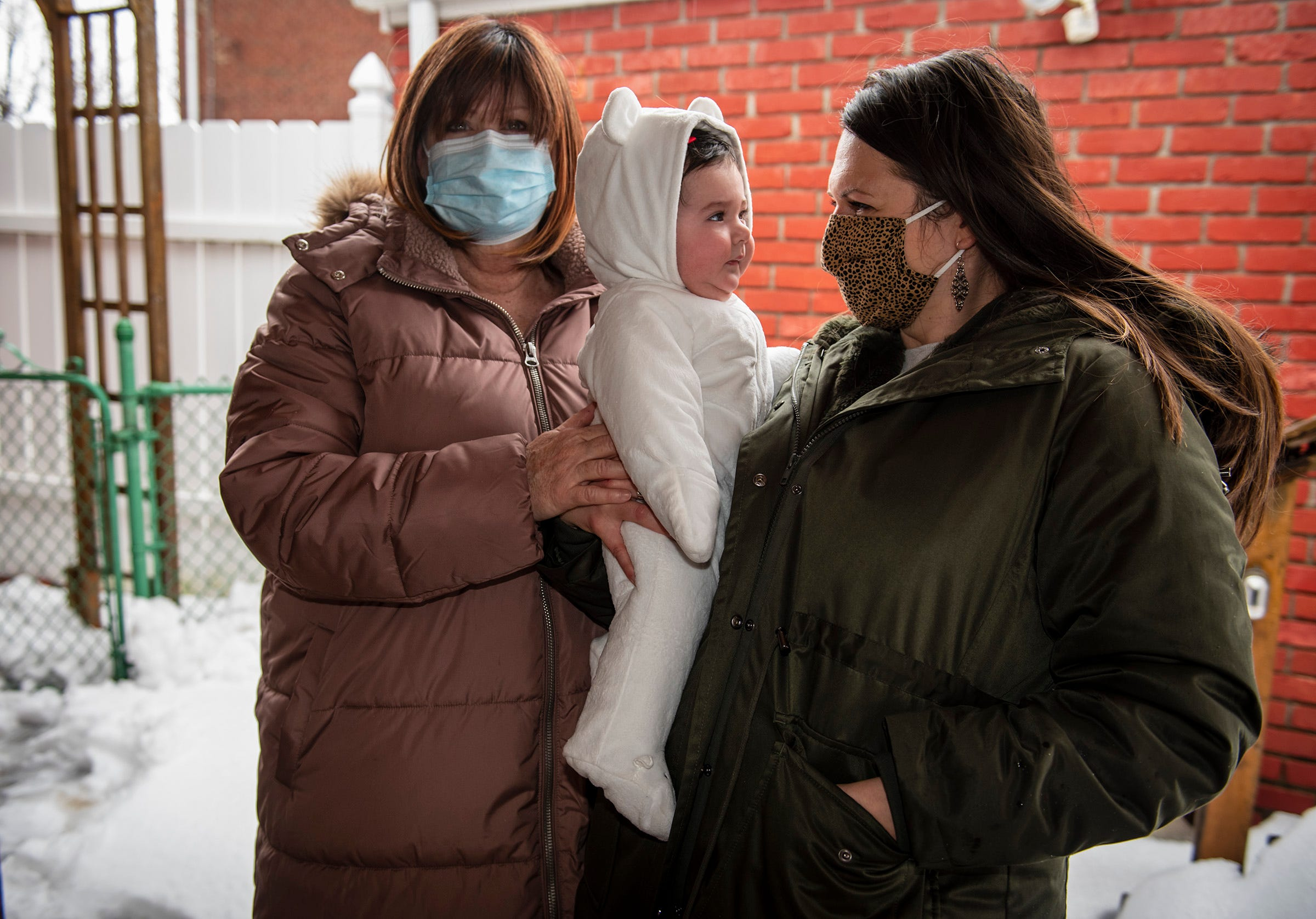 """Emily Snyder, right, of Dormont, works from home while her mom, Arden Vernacchio, right, comes over to take care of her 4-month-old daughter Bridget. """"It's like the world stopped turning,"""" said Snyder, 32."""