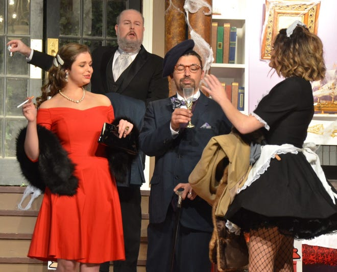"Professor Plum (Levi Packer) accepts a welcoming drink after arriving for dinner in Brownwood Lyric Theatre's production of ""Clue"" now playing.  Shows will continue Friday, Saturday, and Sunday this weekend. Also pictured are, from left to right, Miss Scarlet (Cassia Rose), Wadsworth (Jonathan Harvey), and Yvette (Taffy Watts). Tickets are available at www.brownwoodlyrictheatre.com."