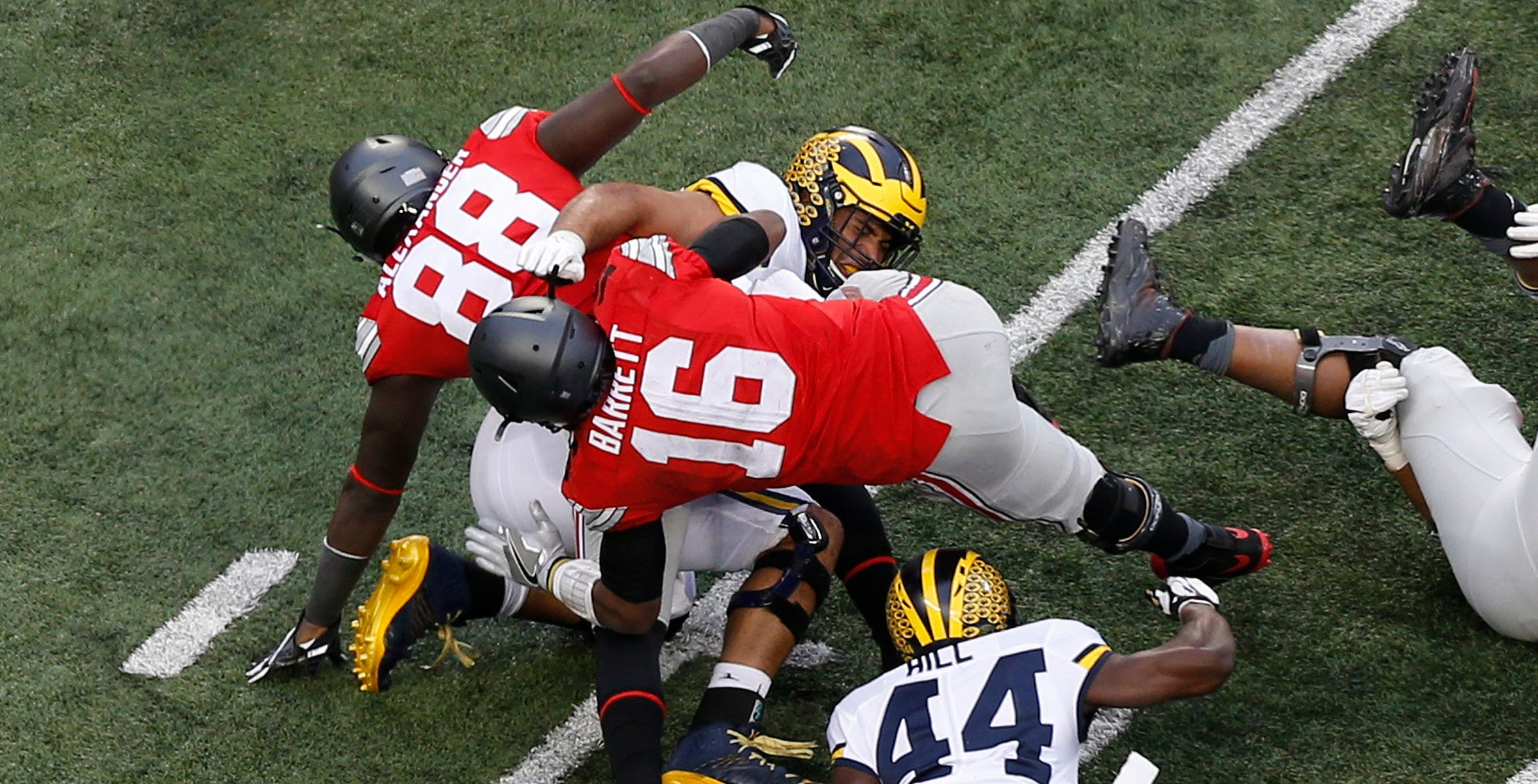 """There is no question where Urban Meyer stands on J.T. Barrett's controversial fourth-down conversion run in the 2016 Michigan game. """"He got the first down,"""" Meyer said."""