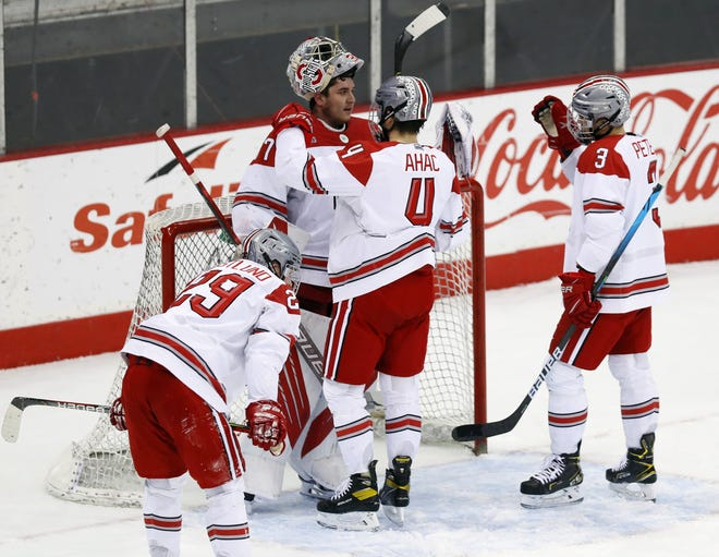 Goaltender Tommy Nappier receives congratulations from his teammates after Ohio State survived to beat Michigan 3-2 on Friday in Value City Arena.