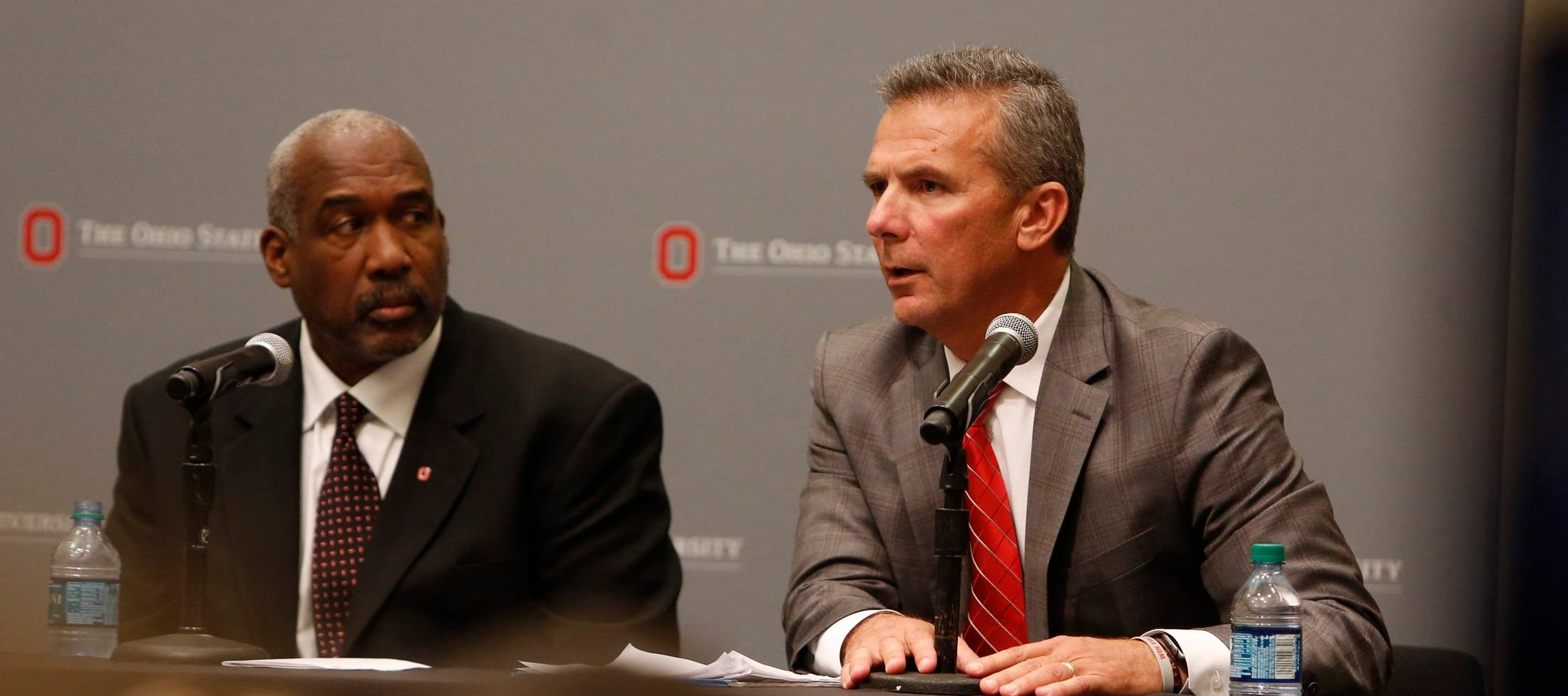 Ohio State football coach Urban Meyer and Athletic Director Gene Smith speak at a press conference on Aug. 22, 2018 at the Longaberger Alumni House.