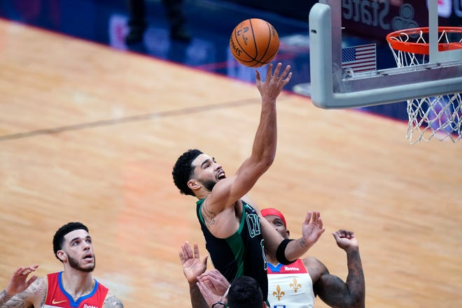 Celtics forward Jayson Tatum goes to the basket against the Pelicans in New Orleans on Sunday.
