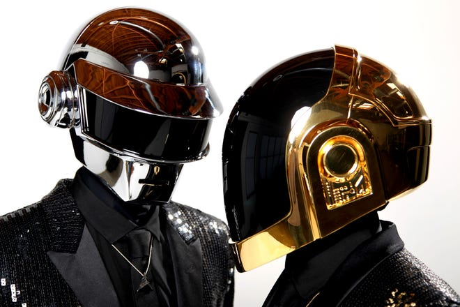 FILE - In this April 17, 2013 file photo, Thomas Bangalter, left, and Guy-Manuel de Homem-Christo, from the music group, Daft Punk, pose for a portrait in Los Angeles. (Photo by Matt Sayles/Invision/AP, File)