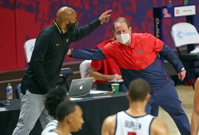 Missouri head coach Cuonzo Martin and Mississippi head coach Kermit Davis meet after a game Feb. 10 at The Pavilion at Ole Miss in Oxford, Miss.