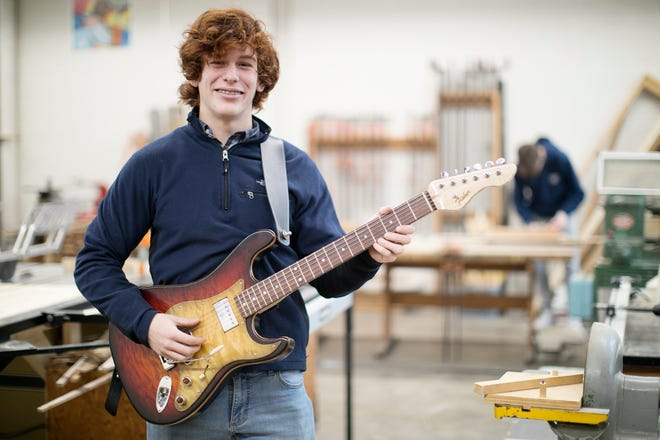 Ben Fisher, a senior at Buckeye Valley High School, wasn't wowed by book shelves or gun racks, so he crafted a replica Fender Stratocaster in his shop class. One Delaware guitar shop owner valued Fisher's guitar at $1,500 and offered Fisher an apprenticeship.