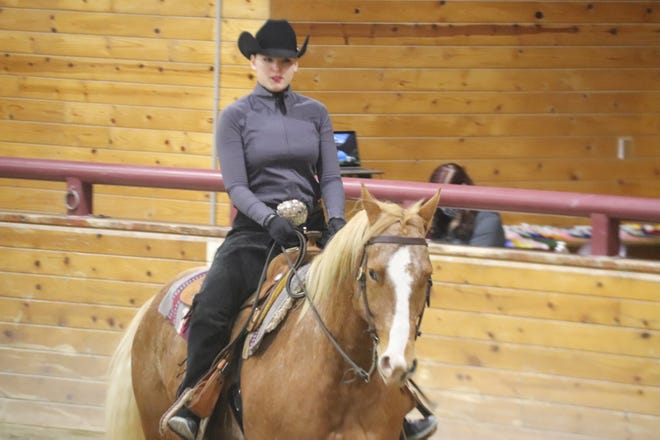 Alyssa Evavold competes at the Minnesota Crookston western equestrian team's home show Sunday, Feb. 21.