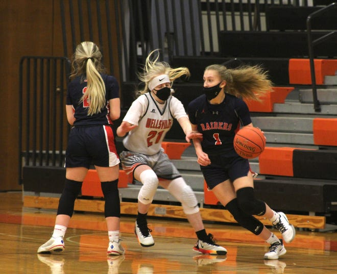 Hornell's Tayghan Doorley (1) dribbles around a screen by Jaden Sciotti (2) as Wellsville's Emily Robbins (21) defends Saturday night.