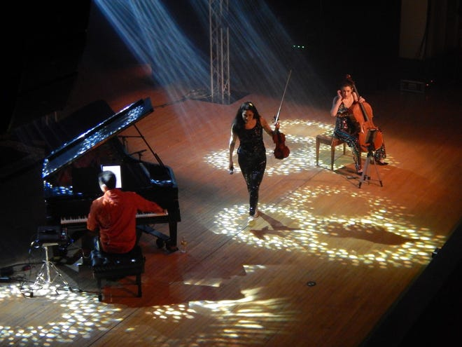 Pianist Jason Stoll, violinist Lindsay Deutsch and cellist Mikala Schmitz take the stage Saturday at Burlington Memorial Auditorium. The California music trio, TAKE3, played a long set of popped-up classical music during their first live show in nearly a year during Civic Music's first event of the season.