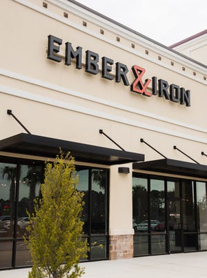 Specializing in ember-roasted entrees and side dishes, Ember & Iron opened Monday at the Shoppes of St. Johns Parkway.