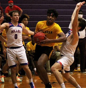West Nassau wing Dallan (Deebo) Coleman battles through the defense of Bolles guards Richie Rosenblum (0) and Bobby Crouch at the Fortegra High School 9:12 Invitational. Coleman was among the nominees to become a potential McDonald's All-American.