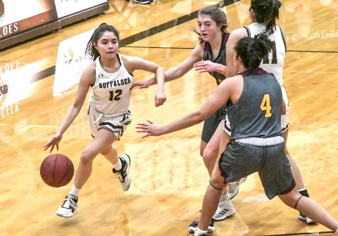 Garden City High School's Kitsely Franco, left, breaks to the basket for a shot off a screen by Aileen Becerril Friday against Hays at GCHS.